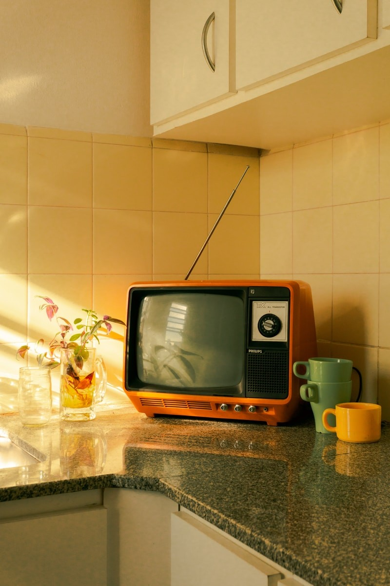 brown crt tv on brown wooden table